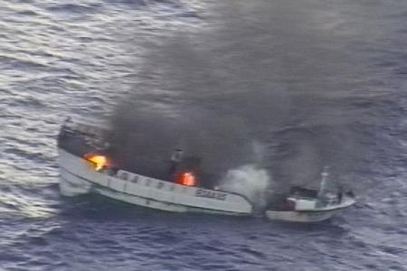 4-23-2012 PHOTO Ten Fishermen Rescued from Burning Vessel in Pacific.jpg