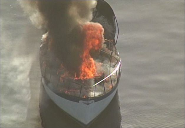 5-11-2012 PHOTO Man rescued from burning boat in agate pass.jpg